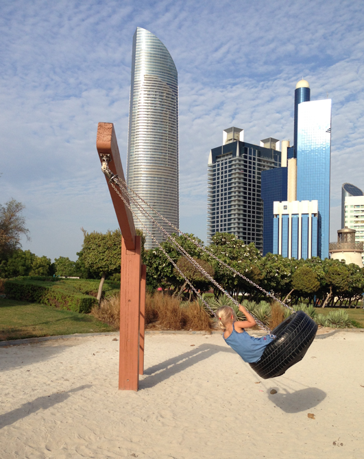 Tire Swing, Abu Dhabi (I love the urban scene in the background!)