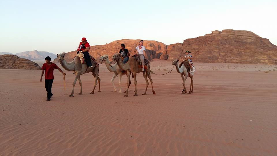 Riding Camels into the Sunset in Wadi Rum