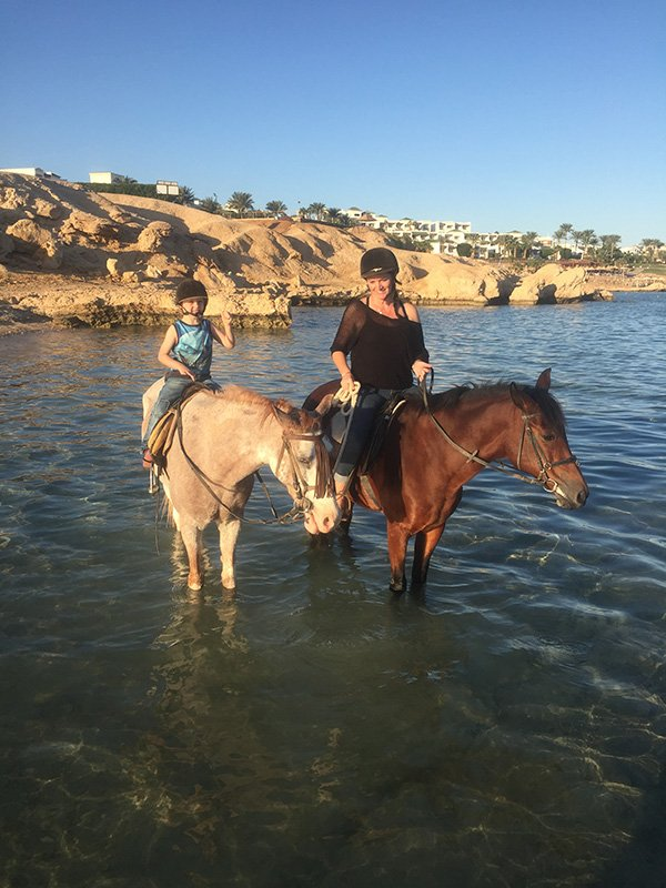 Riding Horses in the Red Sea