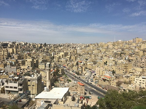 Amman is a mass of white washed building that goes on for miles and miles