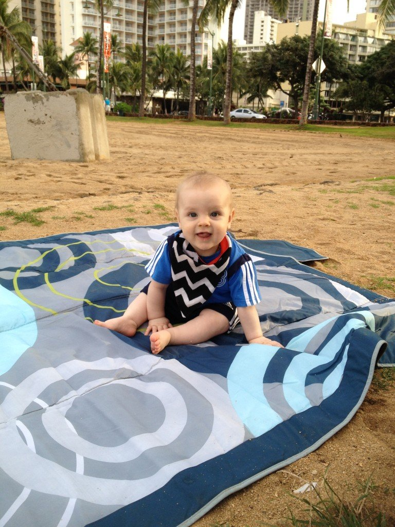 Our go-to beach blanket in action in Hawaii