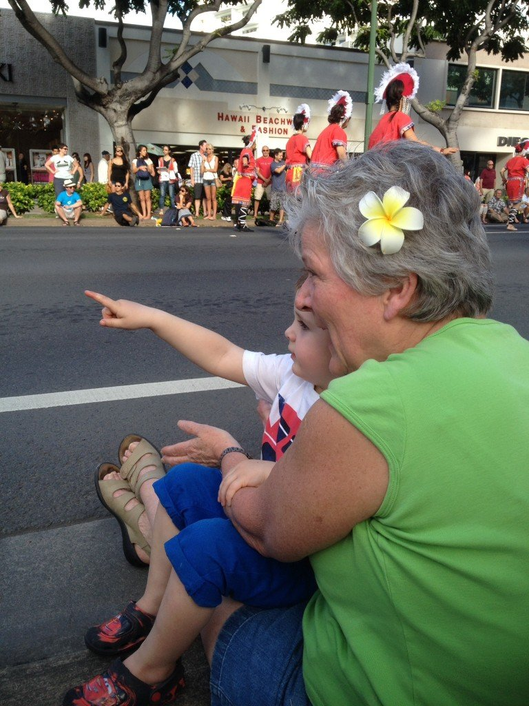 Watching one of the many parades on Kalakaua Ave with Grannie
