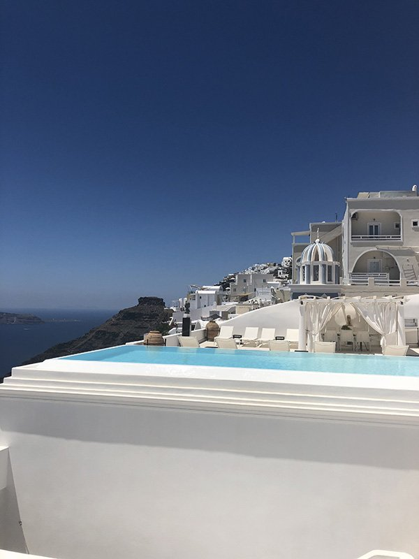 A pool with a view in Fira - One of the luxurious things to do in Santorini on your Itinerary